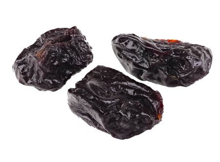 A group of three dried prunes isolated on a white background