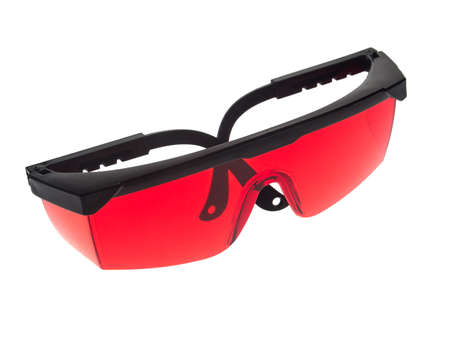 Red glasses used to increase the visibility of the laser beam of a laser level 免版税图像