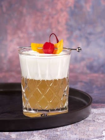 Whiskey sour: a cocktail made with whiskey, lemon juice, simple syrup and egg white
