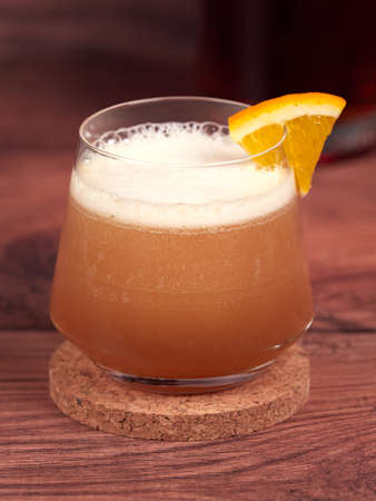 Amaretto sour: a cocktail made with amaretto liqueur, lemon juice, simple syrup and egg white