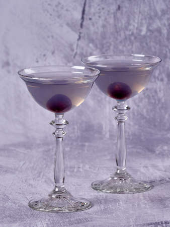 Aviation: a purple-bluish cocktail made with gin, maraschino, creme de violette and a dash of lemon juice, served with a maraschino cherry