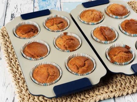 Homemade banana muffins in trays. No sugar added. Toddler food.