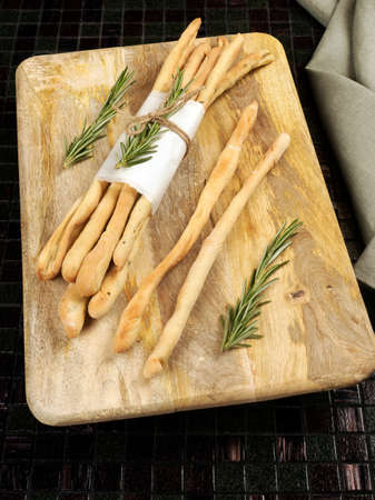 Homemade grissini with rosemary Stock Photo
