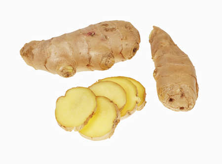 Ginger root and slices of ginger root, isolated on white background 免版税图像