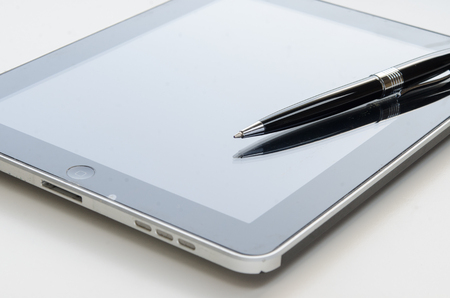 pen put on digital teblet screen with with beautiful reflection