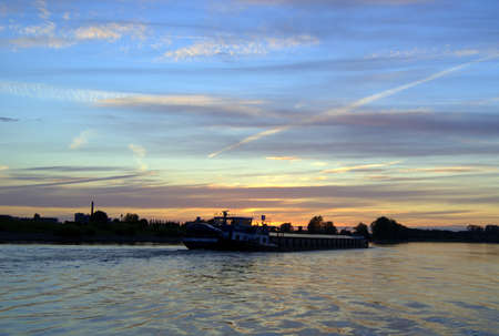 ijssel: A boat in the IJssel during the sunset Stock Photo
