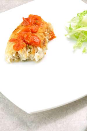 pangasius: pangasius fish with tomatoes