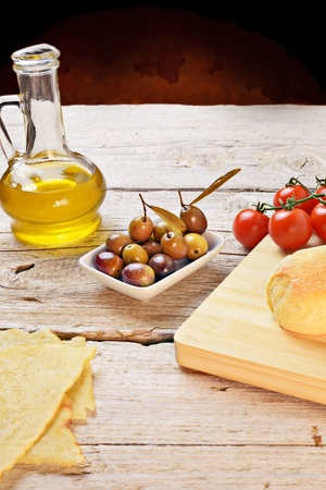 olives, tomatoes and bread photo