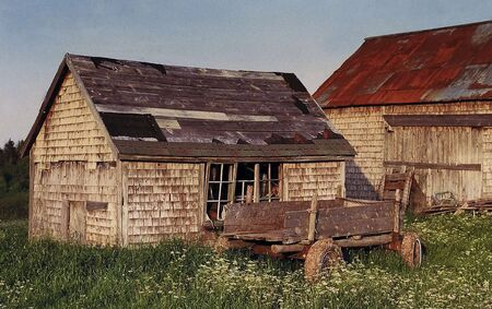 Old shed and a wagon in rural New Brunswick, Canada photo