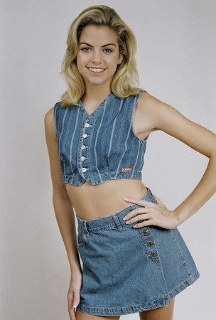 Young teenage girl in a denim outfit