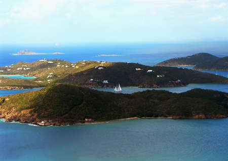 Seascape showing the bay with a sailboat on the Caribbean island of St Thomas