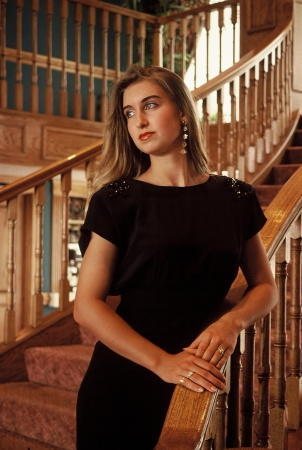 Young attractive woman standing on a stairway Stock Photo - 16250906
