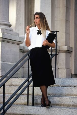 Relaxed pose of an attractive businesswoman standing