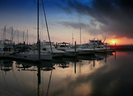 pensacola: Yachts docked at Palafox Pier with a sunset in the background Stock Photo