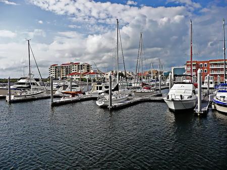 Boats and yachts docked at Palafox Pier in Pensacola, Florida
