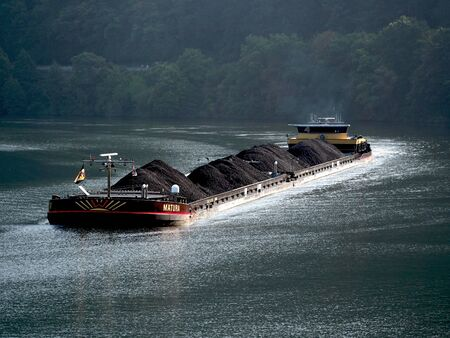 hauling: A barge hauling freight on the Mosel River in Germany
