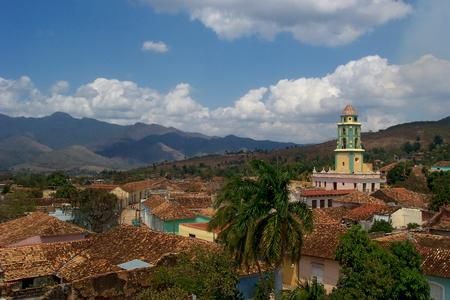 owes: Trinidad, located in the central Cuban province of Sancti Spritus, was founded in the early 16th century but owes its existence and its historical raison dtre to the sugar industry that flourished there and in the nearby Valley de los Ingenios Valley of t