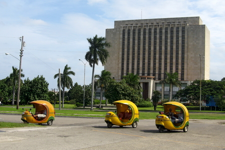 modes: Three-wheeled Coco taxis in Havana, Cuba. It is one of Havanas most popular modes of transportation