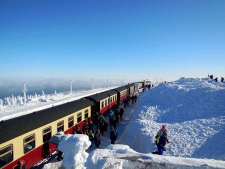 departing: Vacationers departing a train in Brocken, Germany