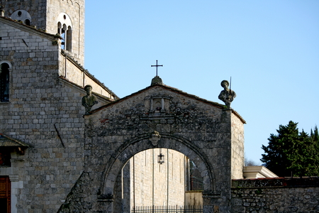 crenellated: The arch at the entrance leads to the square in front of the church, now a grassy lawn Benedictine Cemetery suppressed for centuries and is the only remnant of the crenellated walls of the thirteenth century