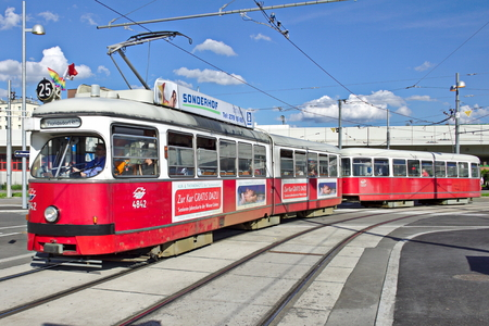 trams: A pair of city trams on a busy street in Vienna, Austria