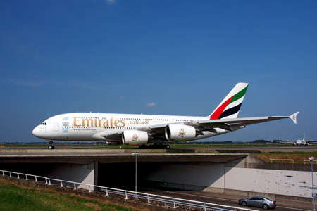 airbus: An Emirates Airbus A380-861 crossing a bridge over a major highway in Rotterdam, Netherlands
