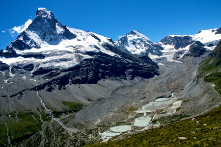 dent: Picturesque view of the Zmutt Valley with the Matterhorn on the left and the Dent dHérens on the right