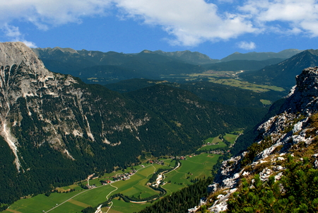 nestled: Picturesque view of a village nestled between the Bavarian Alps Stock Photo