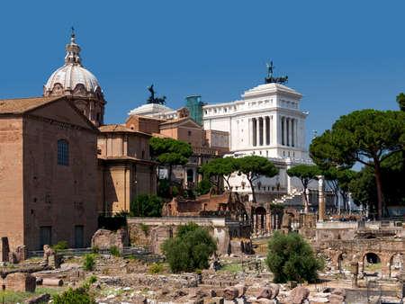 risorgimento: Part of the Roman Forum with the Curia, the dome of the Santi Luca e Martina church, the Risorgimento museum, and back view of the Vittoriano. Rome, Italy Stock Photo