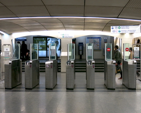 france station: A row of turnstiles at the Paris-Saint-Lazare Metro Station - Paris, France