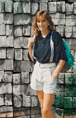 strapped: Young female posing with a backpack