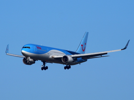 Passenger plane approaching Schiphol, Amsterdam Airport Stock Photo