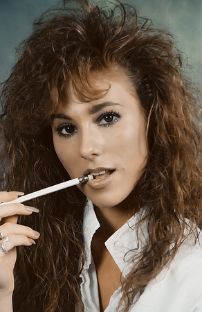 ttractive: Close-up of an ttractive female with a pen in her mouth