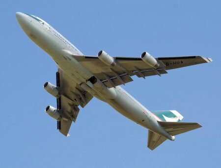 747 400: A Cathay Pacific Boeing 747-400 high above in the sky