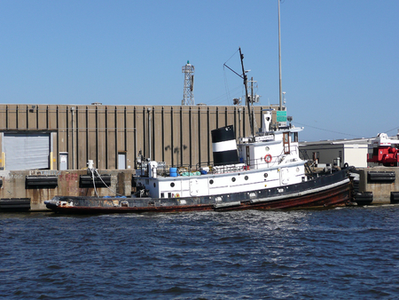 Tugboat: Tugboat docked at pier Editorial