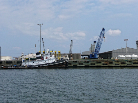 View of a crane and tugboat at the Port of Pensacola