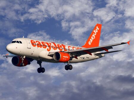 View of an Easy Jet passenger plane up in the sky