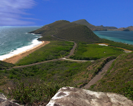 View from the top in St. Kitts. The Atlantic Ocean can be seen to the left and the Caribbean Sea towards the right.