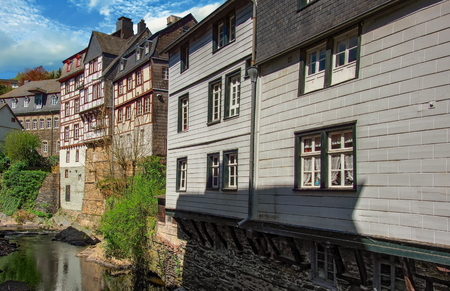 Half-timbered housesl along the banks of the Rur river. Monschau, Germany