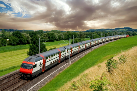 A double-decker intercity train heading towards Lucerne, Switzerland Editorial