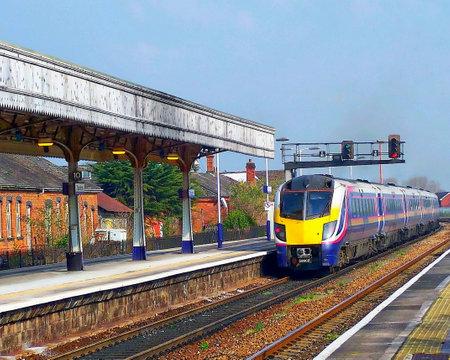 Passenger train departing Taunton - Somerset, England Editorial