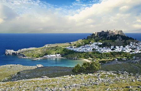 Village of Lindos with a view of one of its many ancient structures on the island of Rhodes, Greece Stock Photo