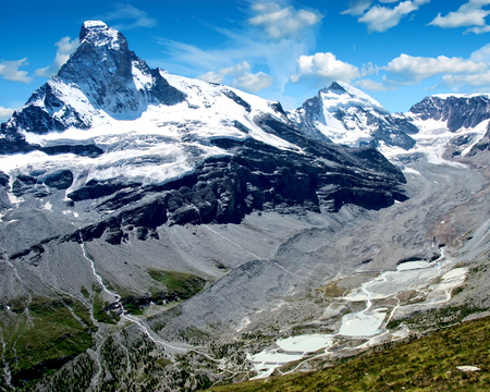 View of the Zmutt Valley with the Matterhorn to the left and the Dent dHérens to the right, Switzerland Stock Photo