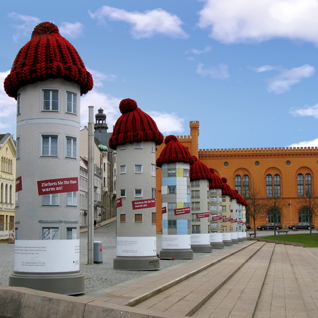 A row of advertising columns with bobble caps in Schwerin, Germany Imagens