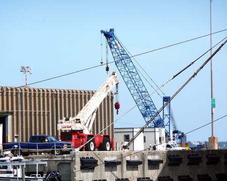 Cranes loading and unloading supplies and cargo at the Port of Pensacola