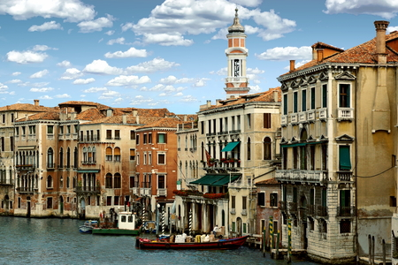 View of the Venice Canal and the Tower of Chiesa dei Santi Apostoli - Venice, Italy Standard-Bild - 115064725
