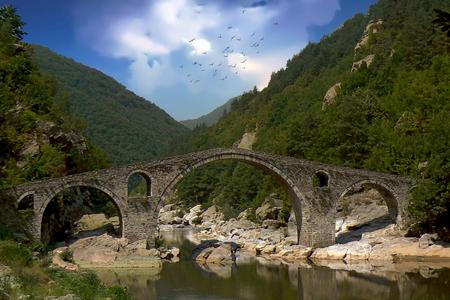 Devil's Bridge spanning the Arda River near Ardino, Bulgaria Standard-Bild - 117353278