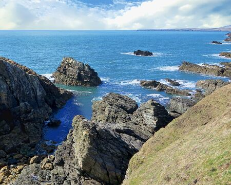Rocks and the Irish Sea along the coast of Wales, England