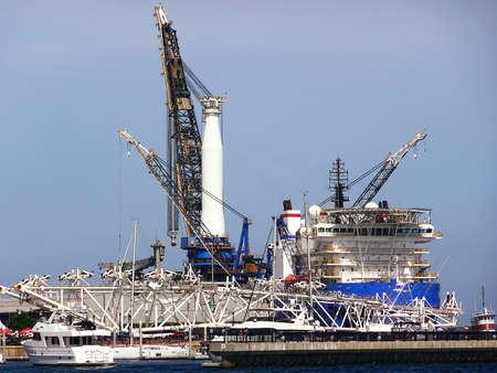 View of a crane and supply ship at the Port of Pensacola, Florida, USA