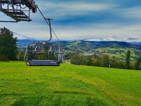 Empty Ski lift at the Zwardon Ski Ski Station located in the Zywiec Beskids, Outer Western Carpathians, Poland 免版税图像